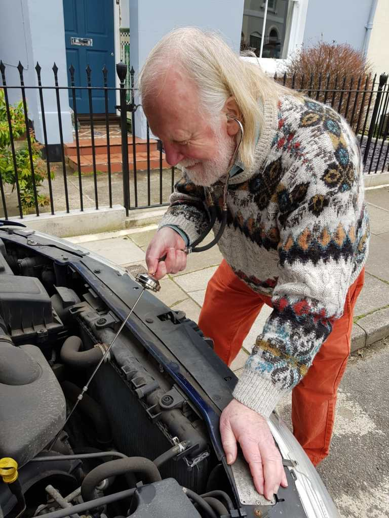 The Author. Listening to car engine using Capac BIN-AURAL with single tectoscope.